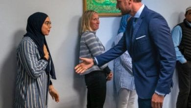 سخر منها لانها مسلمة